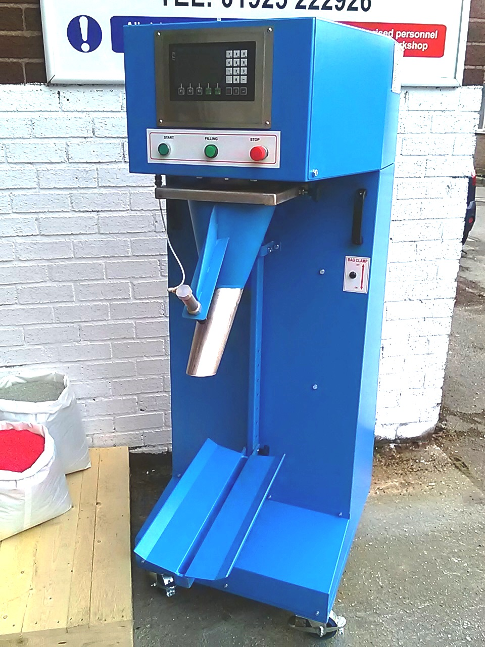 Sack fill and weigh machine